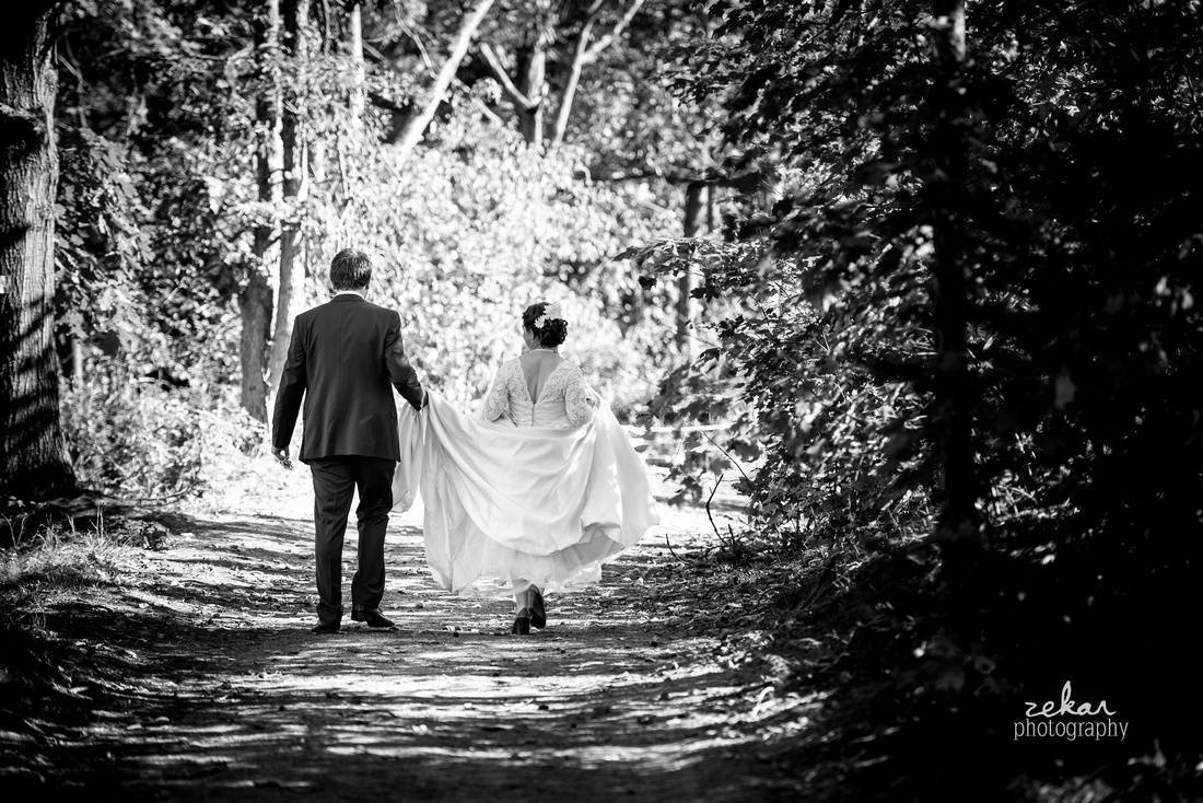 black and white photo bride and groom woods