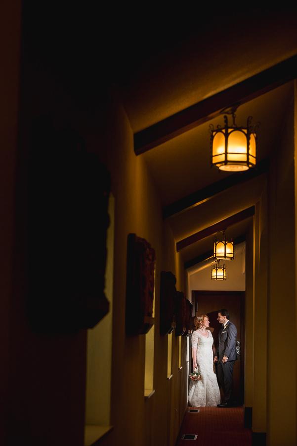 bride and groom in hallway