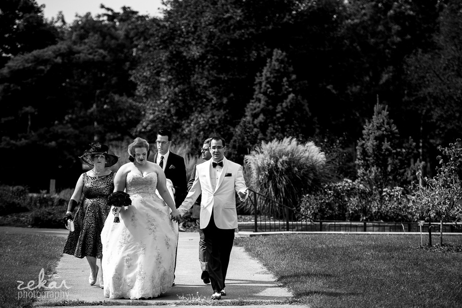 bride and groom walking to ceremony