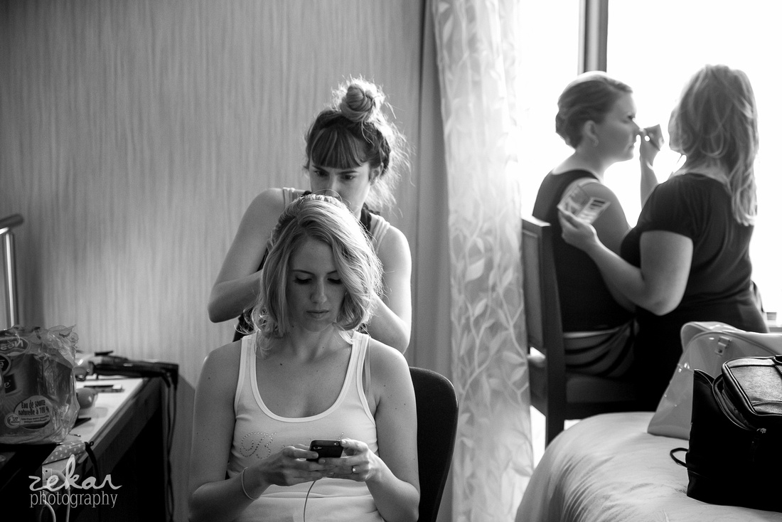 bride texting getting ready