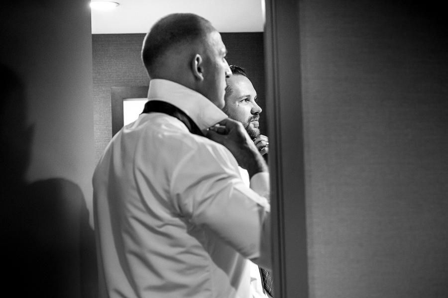 groom getting ready black