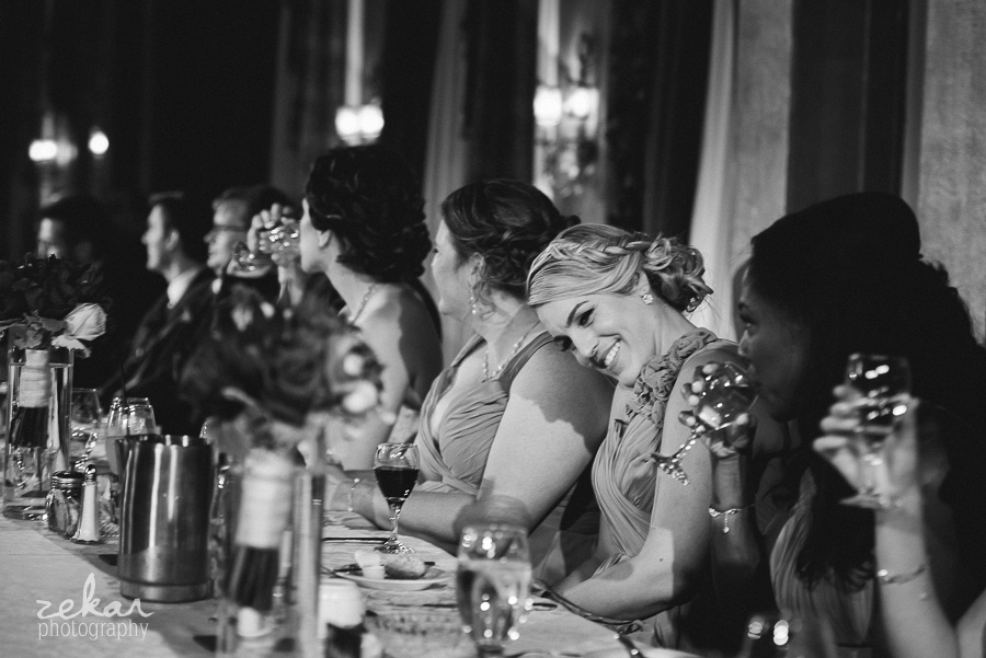 bridesmaids laughing at reception