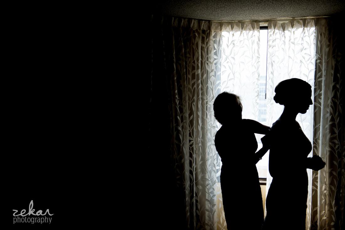 silhouette of bridal getting ready