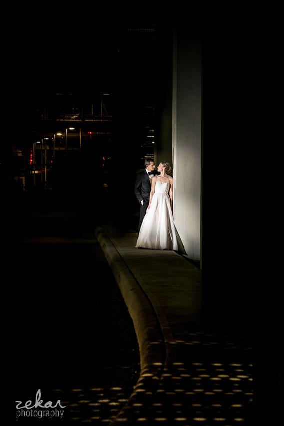 bride and groom portrait under bridge