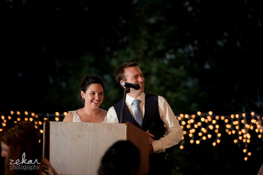 bride and groom giving speech