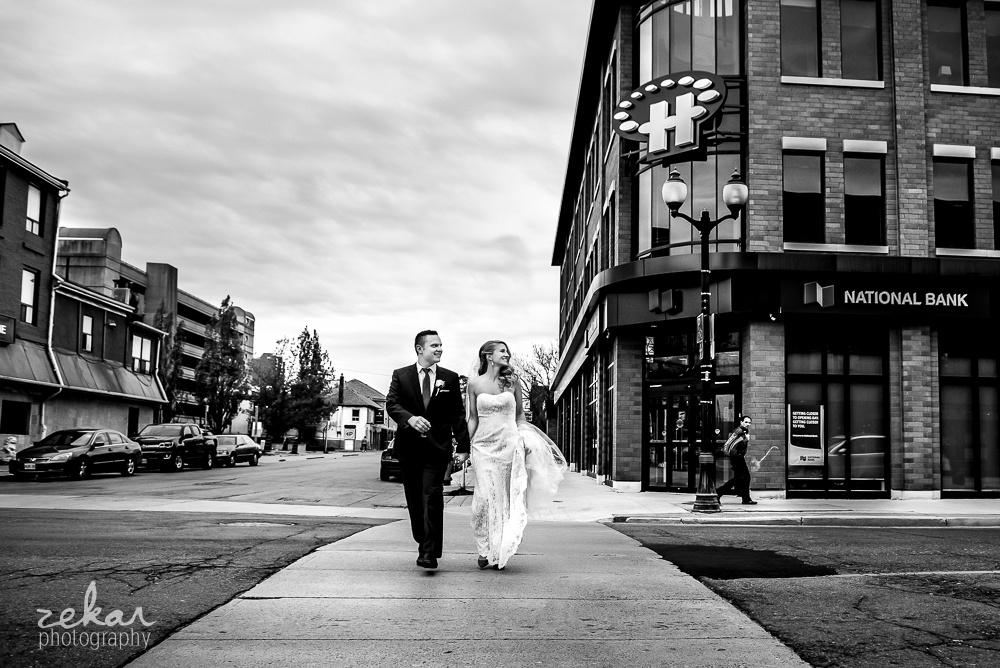 bride and groom walking across street