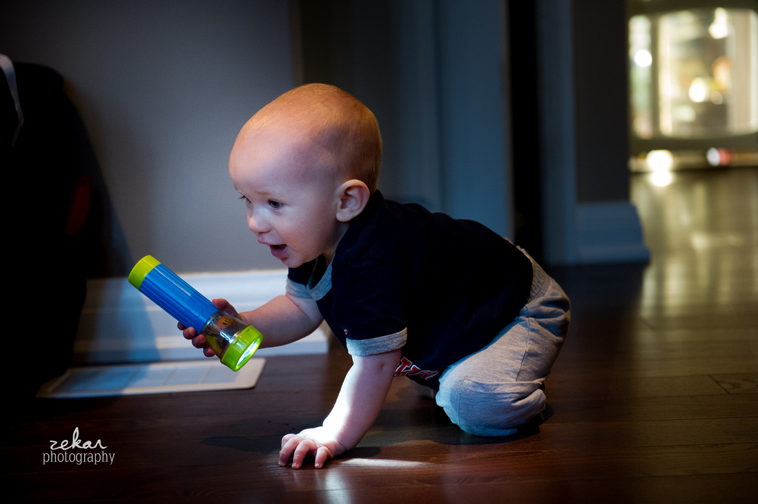 little boy playing with flashlight