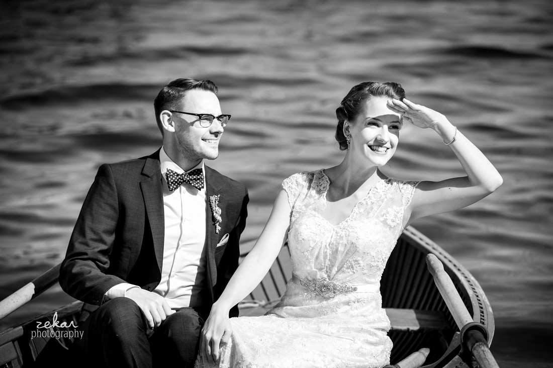 bride and groom in rowboat