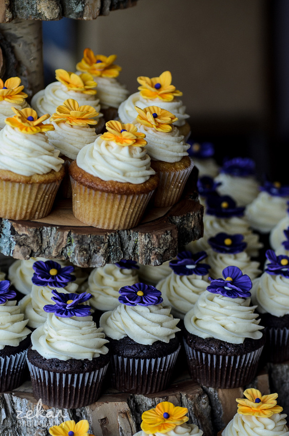 delicious yellow and purple cupcakes