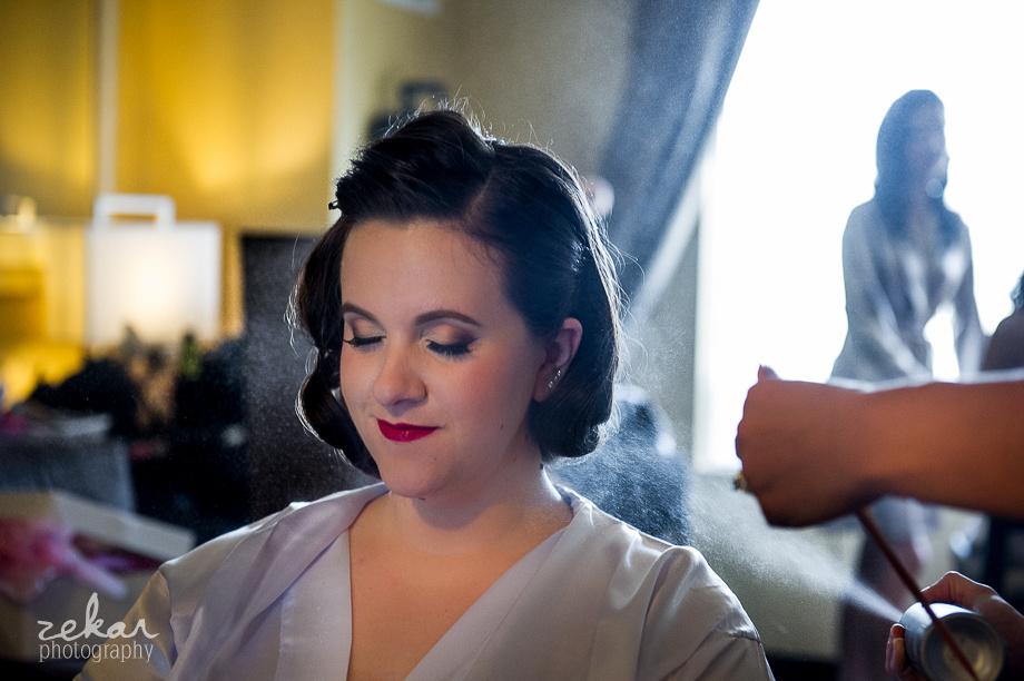 bride getting hairspray on
