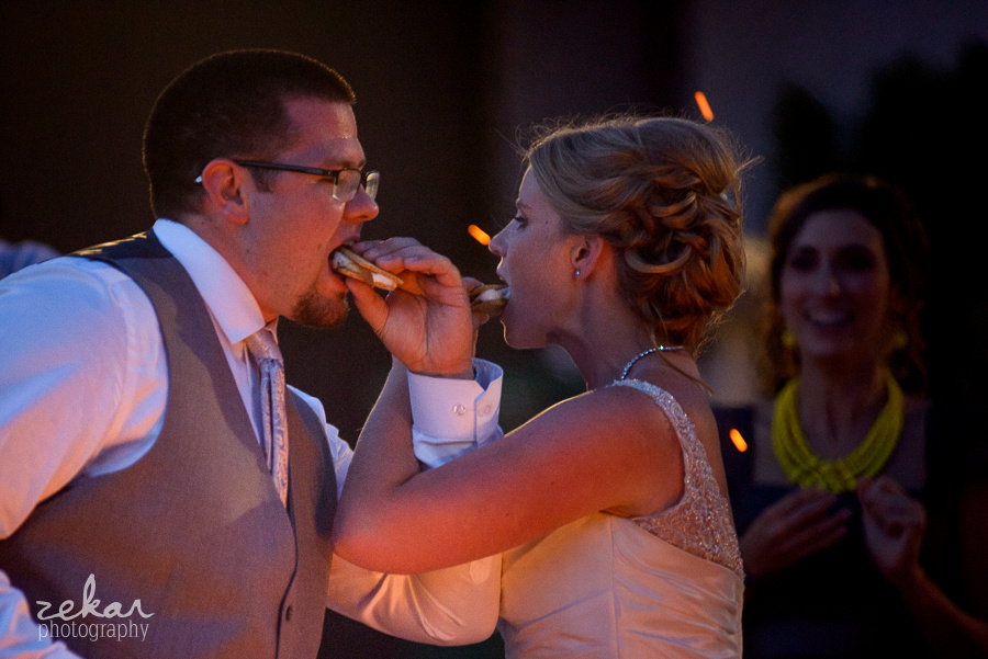bride and groom feed eachother s'mores