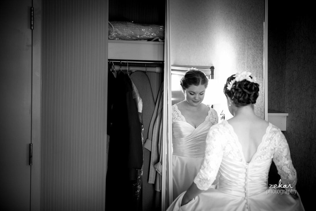 bride looking at self in mirror