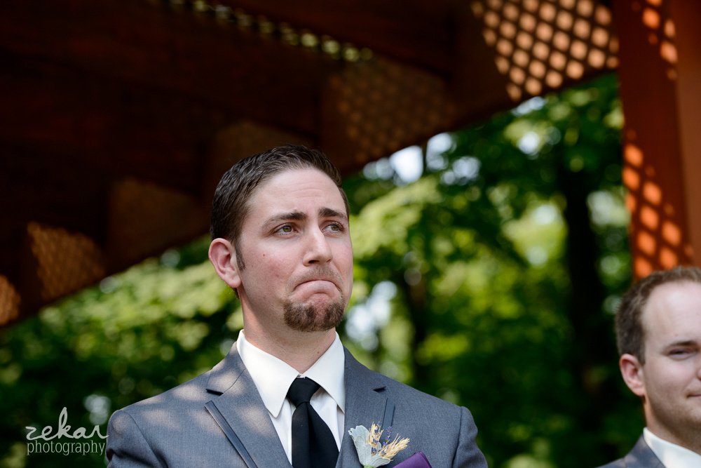 crying groom at altar