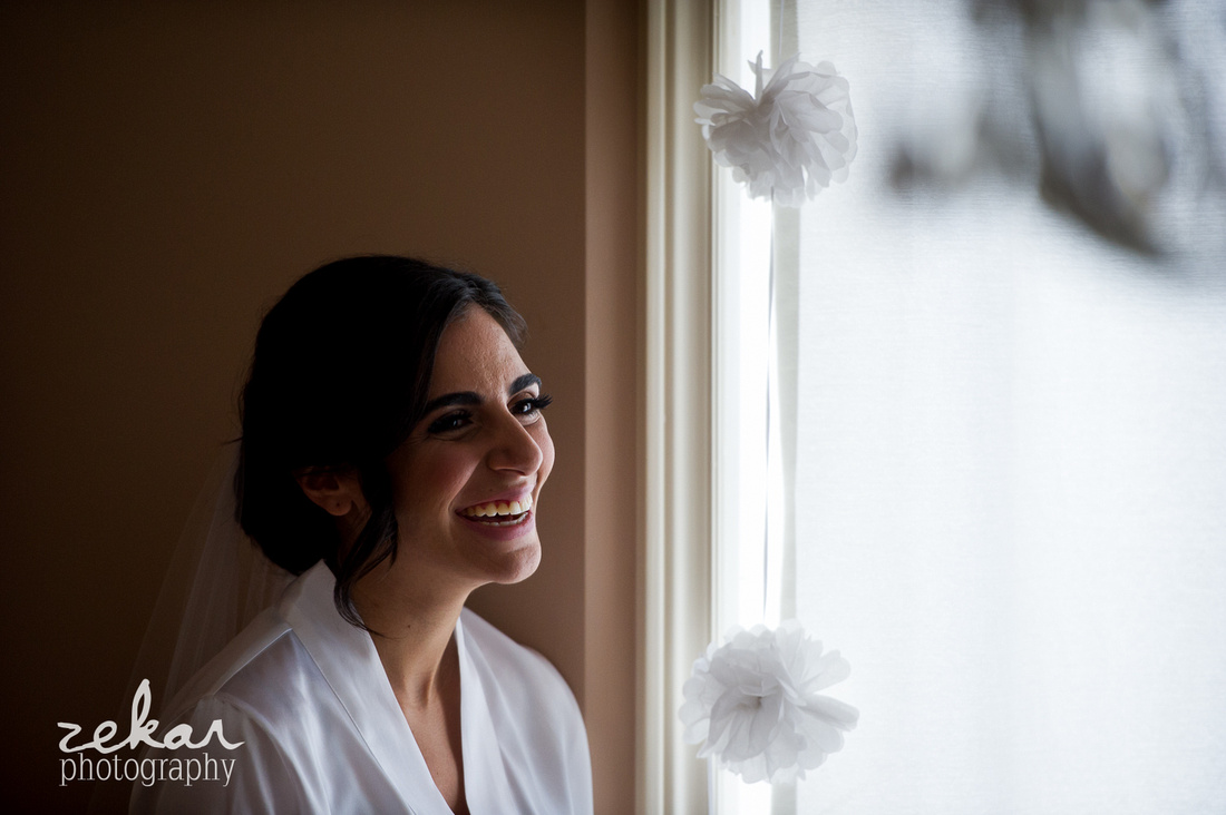 bride laughing near window