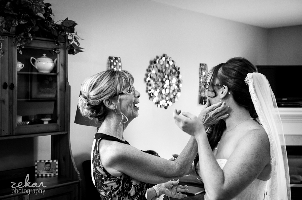 mom smudging lipstick off bride