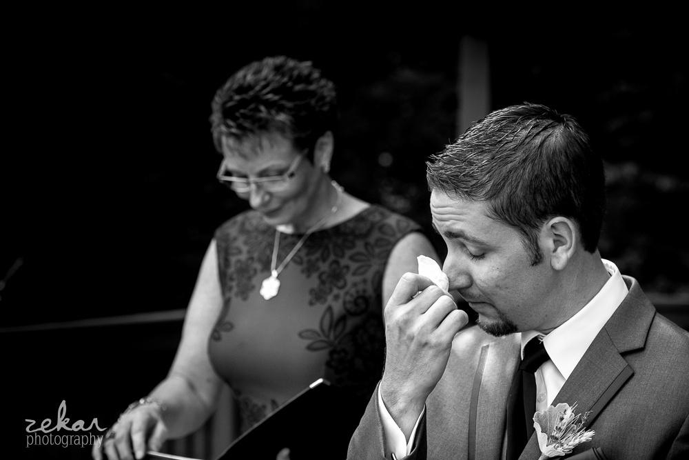 groom using kleenex at altar
