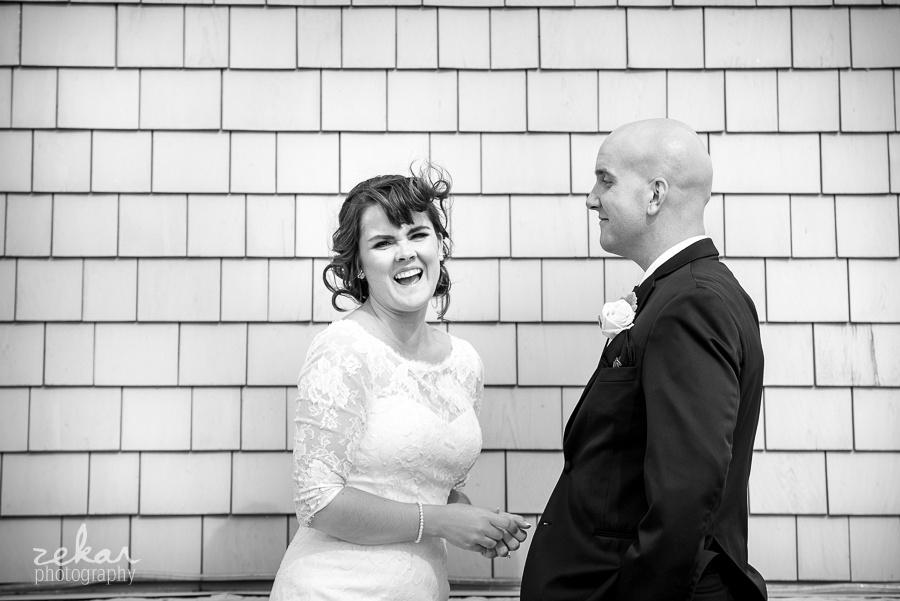 groom making bride laugh